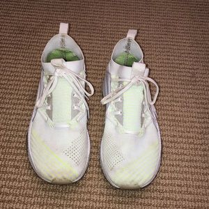 White and lime green Puma tennis shoes